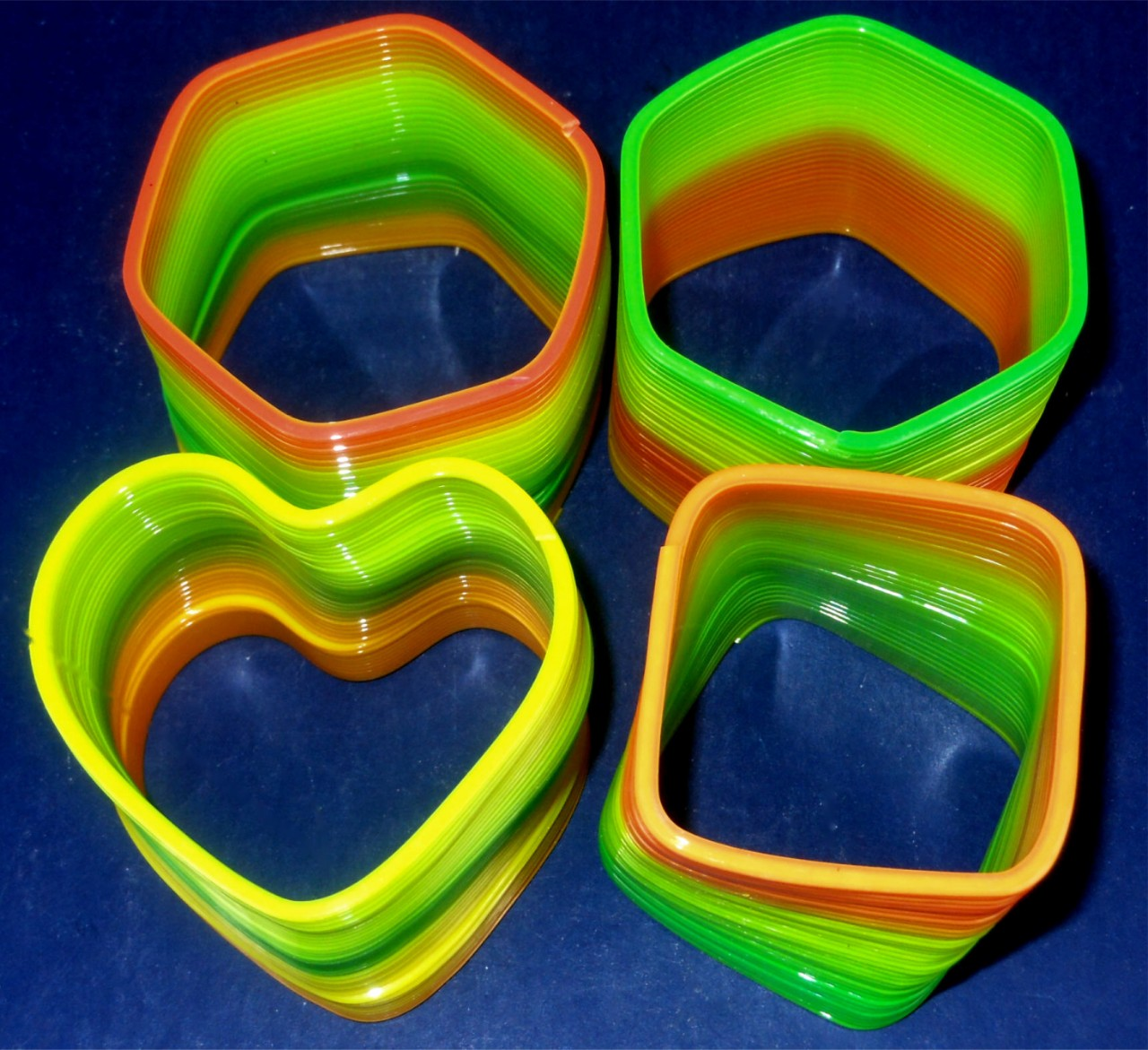 Assorted Shaped SLINKYs 12 per display box .50 EACH